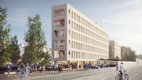 Den nya flervåningsbyggnaden med bostäder utplacerad på planområdet. Byggnadens fasad är ljus. I närheten går en cykelväg av hög kvalitet.