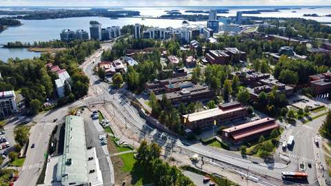 Jokeri Light Rail tracks in Keilaniemi. The aerial view shows streets, residential buildings and the sea.