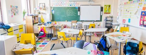 School class, desks and backpacks.