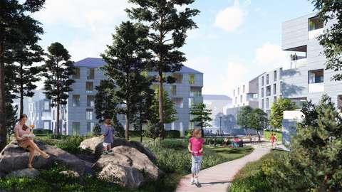 Flervåningshus. I förgrunden park och en gång- och cykelbana.